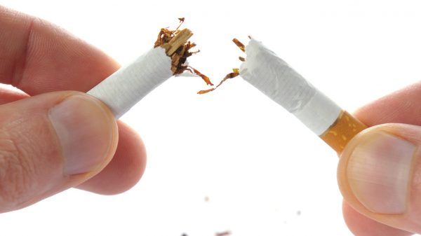 Snapping a cigarette in half in the context over overcoming a smoking addiction